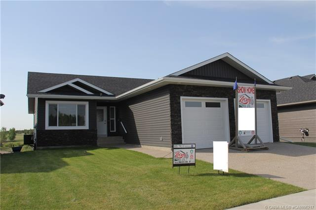 Fully Finished Walkout Bungalow Backing onto Water in the Beautiful Valleyview West Subdivision!